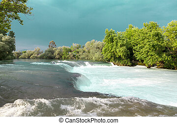 Water rapids. Mountain river, forest green rapid waterfall....