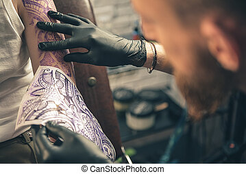Male assimilating picture on arm with archetype - Man...
