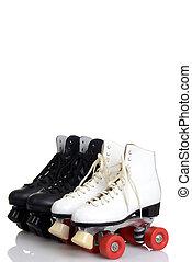 black and white quad roller skates
