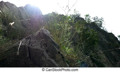 Sun rays through rocks