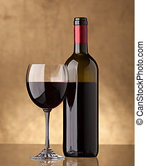 A bottle of red wine and filled a wine glass