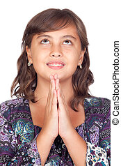 Adorable preteen girl praying isolated on white background