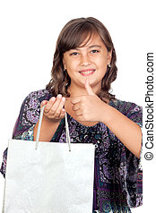 Adorable preteen girl shopping saying OK isolated on white...
