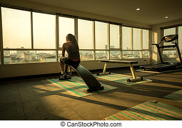 Woman frustrated and tired in sport club