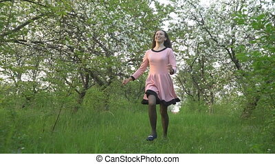 Woman running in a blooming garden - Woman running in a...