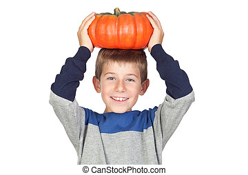 Adorable child with a big pumpkin on his head isolated on...