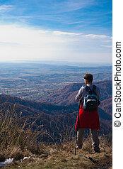 tourists on mountain top - Tourists on mountain top looking...