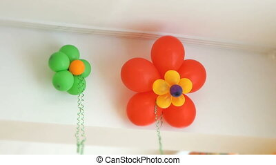 Two figures from air balloons hanging on wall