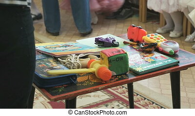 Educational games. Children's books, toys on table