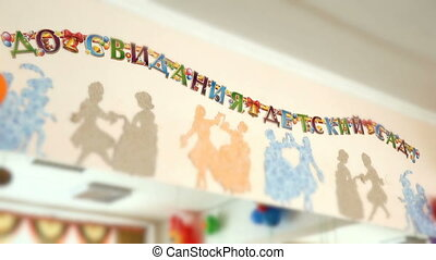 Inscription on wall : Goodbye kindergarten - Inscription in...