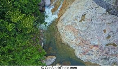 Drone Flies Close along Clean Fast Mountain Stream - drone...