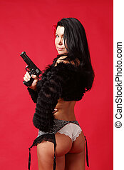 Sexy woman with gun - Sexy woman in lingerie with a gun.