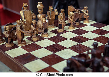 wood chess pieces on board game