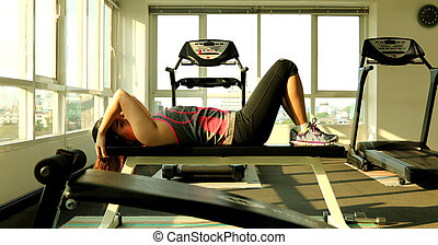 Athlete woman exercising in fitness club.