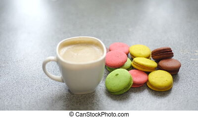 macaroons and coffee on a table