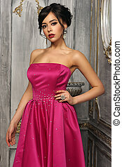 Elegant lady wearing ball gown - Pretty lady wearing pink...
