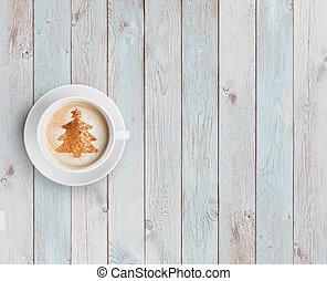 coffee mug with christmas tree on white wood table