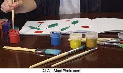 Kid Girl Painting Flowers - Kid artist girl painting flowers...