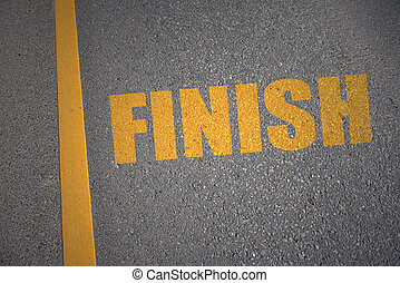 asphalt road with text finish near yellow line