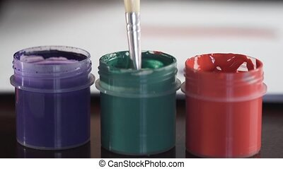Gouache Ink Jars - Thin brush and colorful jars of ink,...