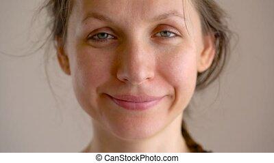 Beautiful caucasian woman smiling at camera after waking up