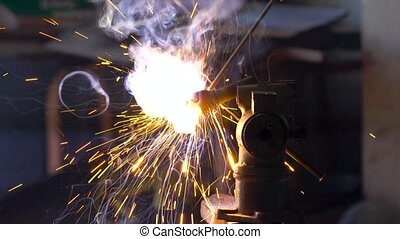 Welding process for metal close-up. Slow motion.