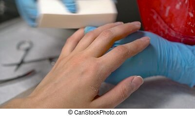Manicure process in beauty salon, close up - Woman in a nail...
