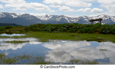 Beautiful mountain landscape - Reflection of clouds in a...