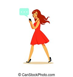 Young woman walking and sending a message to someone using her smartphone