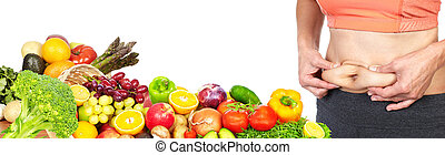Woman belly fat - Female abdomen fat and fruits isolated...