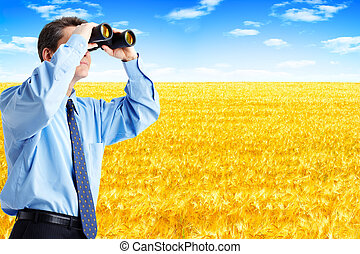 Business man - business man with binoculars looking to the...