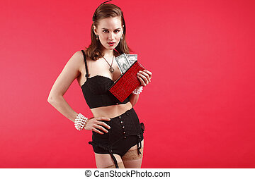 Sexy young woman with purse