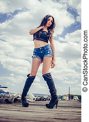 Hot fashion stylish woman posing in sexy high black boots -...