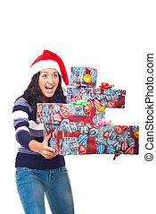 Amazed woman with gifts ready to fall - Amazed woman holding...