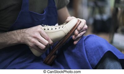 Shoemaker glues loafer to its sole