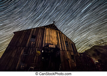 Star trails forming over barn - Star trail photography...