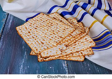 Jewish bread matza on wood matzah or matza on a vintage wood