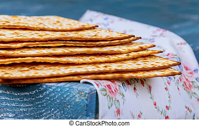 Stack of matzah or matza on a vintage wood background with...
