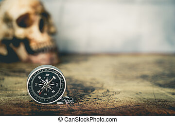 Skull and compass on vintage map copy space