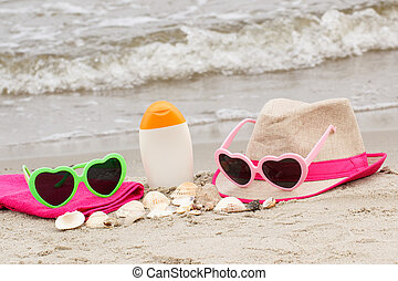 Accessories for vacation on sand at beach, concept of sun protection and summer time