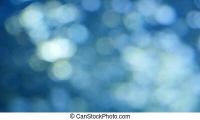 Abstract background with beautiful flickering particles. Underwater bubbles in flow with bokeh
