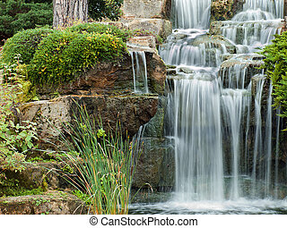 Peaceful waterfall - Beautiful water cascade at Londons Kew...