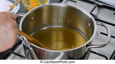 Chef preparing caramel sauce - Cooking caramel. Chef...
