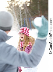 Fun - Image of attractive young woman flinging the snowball...