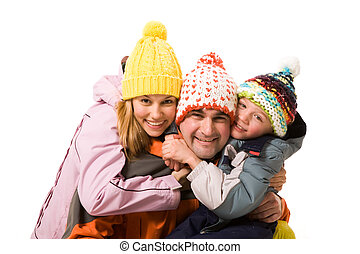 Strong love - Image of cheerful family embracing each other...