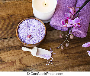 Spa setting with bath salt, orchid , candle, towels and on...