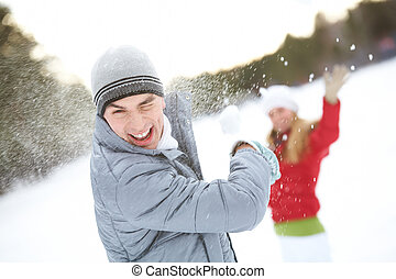 Guy laughing - Image of attractive young man laughing while...