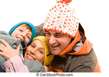 Happiness - Image of cheerful family looking at camera over...