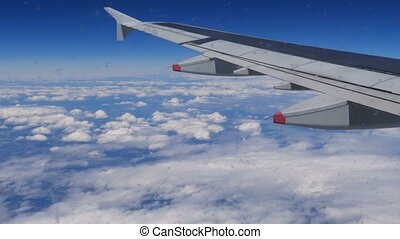 Clouds and blue sky from the plane. Traveling by air. -...