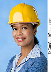 Successful engineer - Portrait of pretty female with helmet...